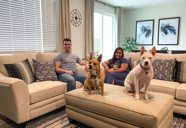 Rowena and Sam with their three dogs