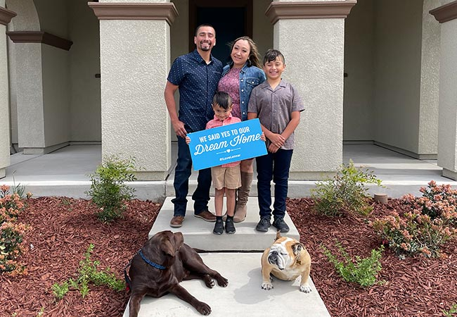 Maricel and Jose with family outside their new home at Tracy Hills.
