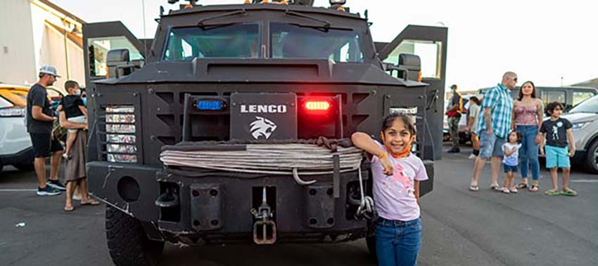 Girl standing in front of a LENCO car